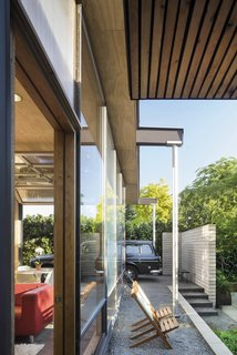 "For Seattle architects Matt Wittman and Jody Estes, the slow road to upsizing really paid off.<br>Facing rising housing costs downtown, they traded an apartment for a small house in a gritty neighborhood, sensing promise in a deep, skinny lot with a scrap-filled yard. A crushed stone perimeter fills in the carport and steps to the courtyard. Wittman explains: ""We wanted to continue the blurring of Japanese landscape design with modernists like Mies van der Rohe and Frank Lloyd Wright."""