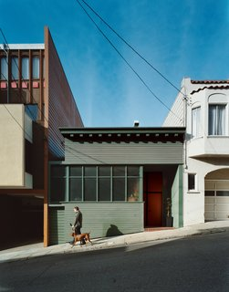 Farnham walks the couple's Vizsla, Kasia, down the sloped alley upon which the <br><br>house sits. Hill's renovation maintains some Victorian character in the decorative eaves <br><br>and scaling, but the home is largely an anomaly for San Francisco.