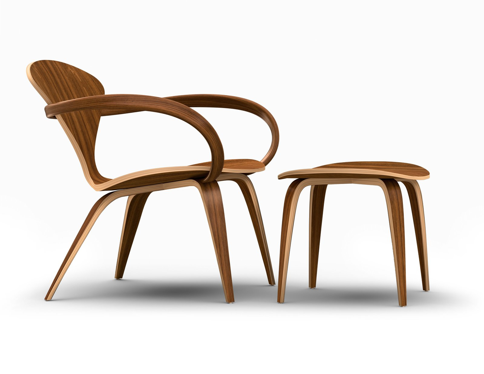 The side view of the Cherner Lounge Arm Chair and Ottoman showcases the sinuous curvature of the molded plywood. This design recalls the look of the original chair designed by Norman Cherner in 1958.  Photo 12 of 24 in A Cherner Chair Retrospective from Reviving Classics with The Cherner Chair Company
