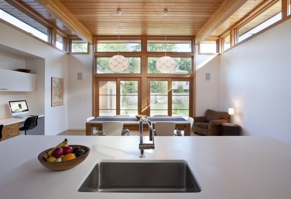 Clerestory windows on both sides of the kitchen in this home ensure that there's always enough daylight in the space, even on cloudy days. The use of operable windows also means that cross-ventilation is possible for warmer days.