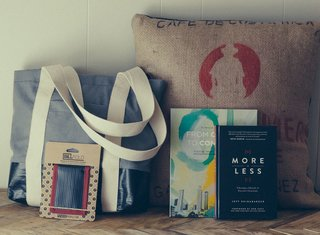 Plywood People's Billboard Bags are made from upcycled billboard materials and coffee bags by refugees who fled conflict-plagued countries for Clarkston, Georgia. Workers receive job training, English lessons, and income through the project. Photo courtesy of Plywood People.