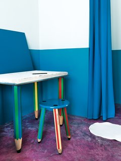 The pencil-themed desk and stool are by Pierre Sala.