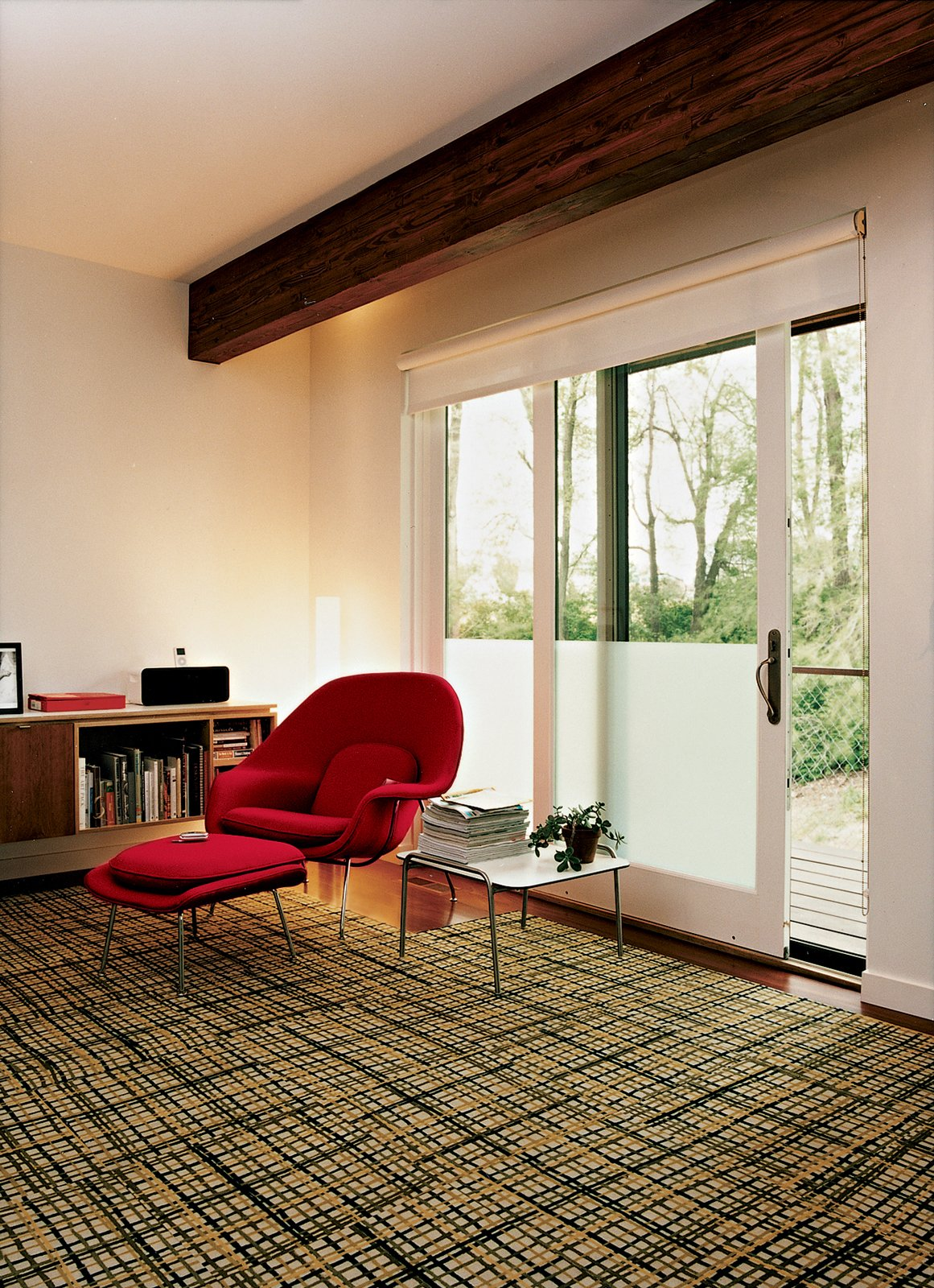 Living Room and Chair An Eero Saarinen Womb chair sits in the master bedroom, which also has a small office space.  Photo 5 of 10 in Design Classic: Eero Saarinen's Womb Chair from Affordable, SIP-Built Family Home in Kansas City