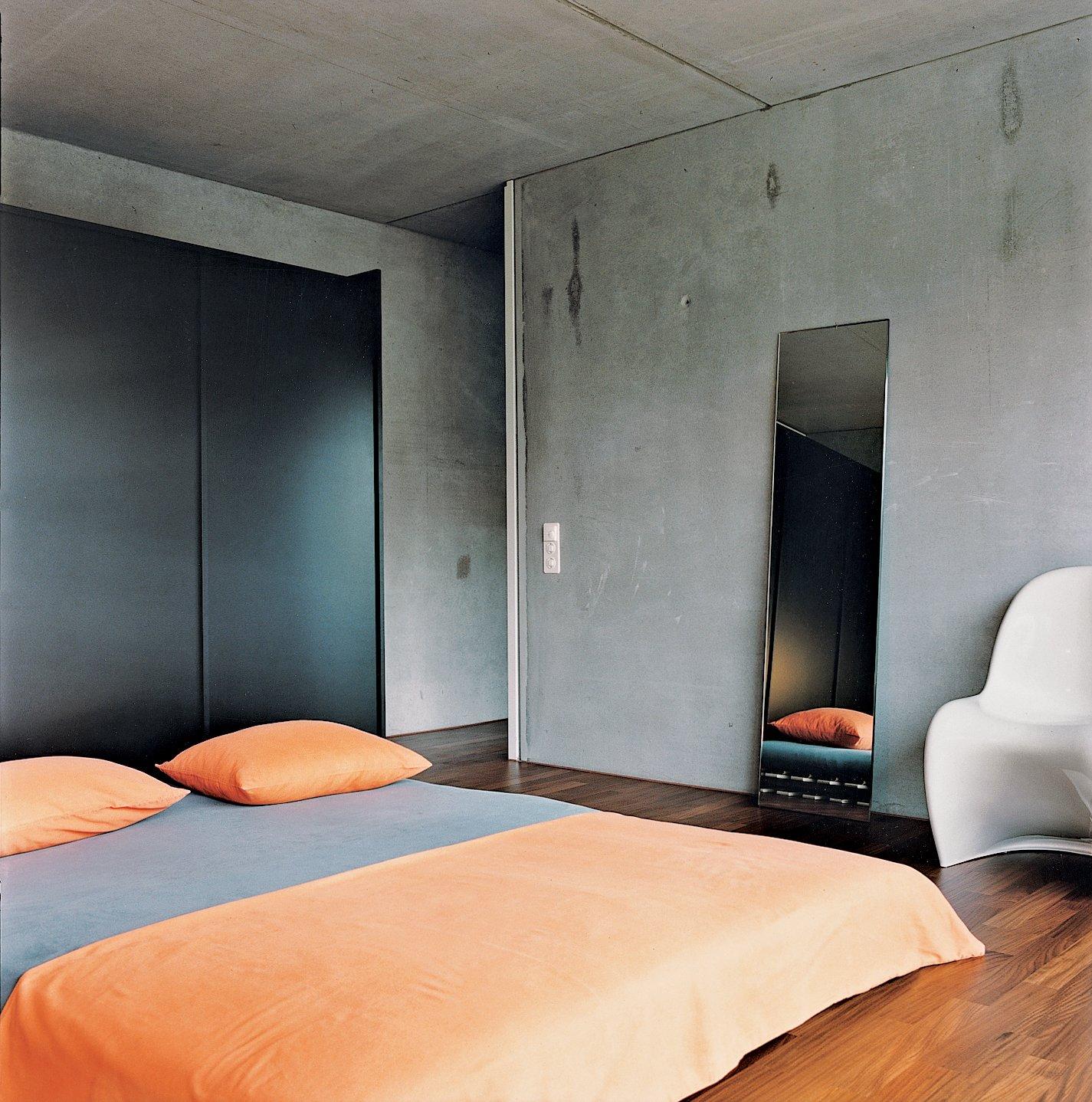 Bedroom, Bed, Medium Hardwood Floor, and Chair The master bedroom is spartan.  Photo 10 of 11 in Swiss Mix