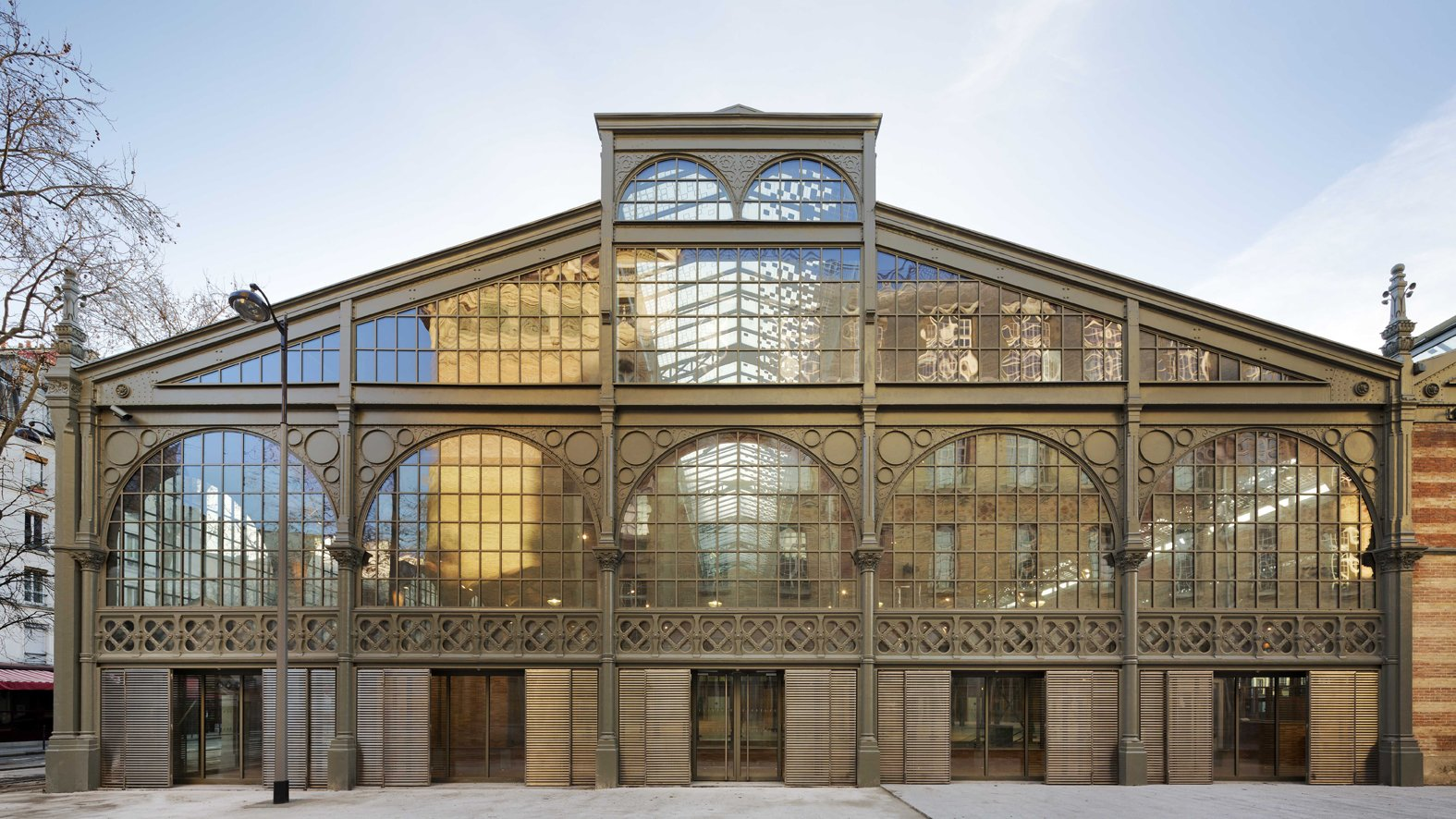 "Carreau du Temple Facade   ""It captures that feeling of being in Paris, the subtle light of Paris,"" says architect Jean-François Milou.  Photo Credit: Fernando Javier Urquijo/studioMilou architecture.  Photo 1 of 9 in Carreau du Temple: Parisian Poetry in Glass and Steel"