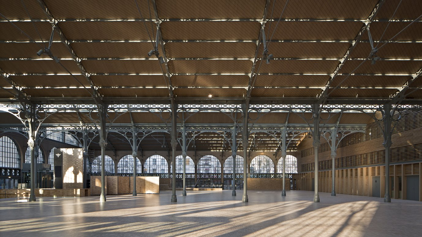 """View from the Nave of Carreau du Temple  """"Because it's one of the only remaining examples of this type of architecture, we have a responsibility to make the restoration ideal,"""" Milou says. """"We wanted to make it even lighter than it was, even more free, to truly open up the roof and the envelope.""""  Photo Credit: Fernando Javier Urquijo/studioMilou architecture.  Photo 8 of 9 in Carreau du Temple: Parisian Poetry in Glass and Steel"""