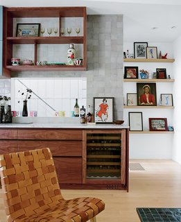 Driven by the death of several appliances, a San Francisco family finds that a spanking new kitchen delivers a good dose of domestic harmony along with the excuse to execute a complete home makeover. The Sub-Zero beverage chiller sits in easy proximity to the lounge area adjacent to the kitchen. Risom lounge chairs were rewoven with cat claw–proof leather strapping after the originals were shredded.