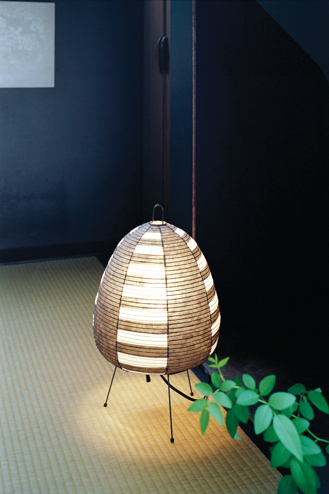 The teahouse is lit by Isamu Noguchi's classic mid-century Akari 1AS lamp.  Photo 11 of 11 in Small Space Live/Work Box Home in Japan