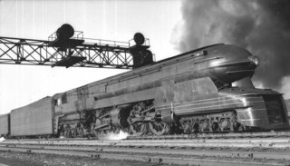 """Design Icon: 8 Works by Raymond Loewy - Photo 2 of 9 - PRR S1 Locomotive for Pennsylvania Railroad (1939)<br><br>""""It flashed by like a steel thunderbolt, the ground shaking under me, in a blast of air that almost sucked me into its whirlwind.""""  Loewy's description of this one-off locomotive he designed for the Pennsylvania Railroad company belies his talent for self-promotion. It also captures the excitement of this steel behemoth, a projectile at rest that's more steampunk than anything Jules Verne could have imagined. Sadly, after debuting at the 1939 World's fair, Loewy's creation had a short career, retiring from the rails in the mid-'40s due to performance issues."""