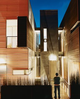 Jorge appreciates his efforts at twilight. The polycarbonate panels that partially clad the exterior of the structure provide a warm glow, adding life to Tijuana's densely packed rolling hillsides