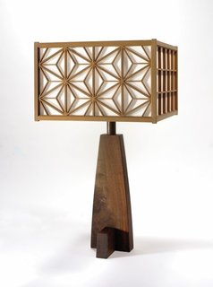These intricately patterned lamps were created to illuminate Nakashima's work at a show overseas. Some of these reside in the Rockefeller's mansion.