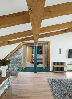 Different types of reclaimed wood, each from different sources, steal the show in this residence in the Scottish countryside by Glasgow-based architect Andrew McAvoy of Assembly Architecture. Thick, deep oak beams were reclaimed and reused for structural elements, while the maple flooring was salvaged from an old school in the nearby rural village of Aberdeen. The reclaimed wood was a critical contributor to the goal of sustainability in the home.
