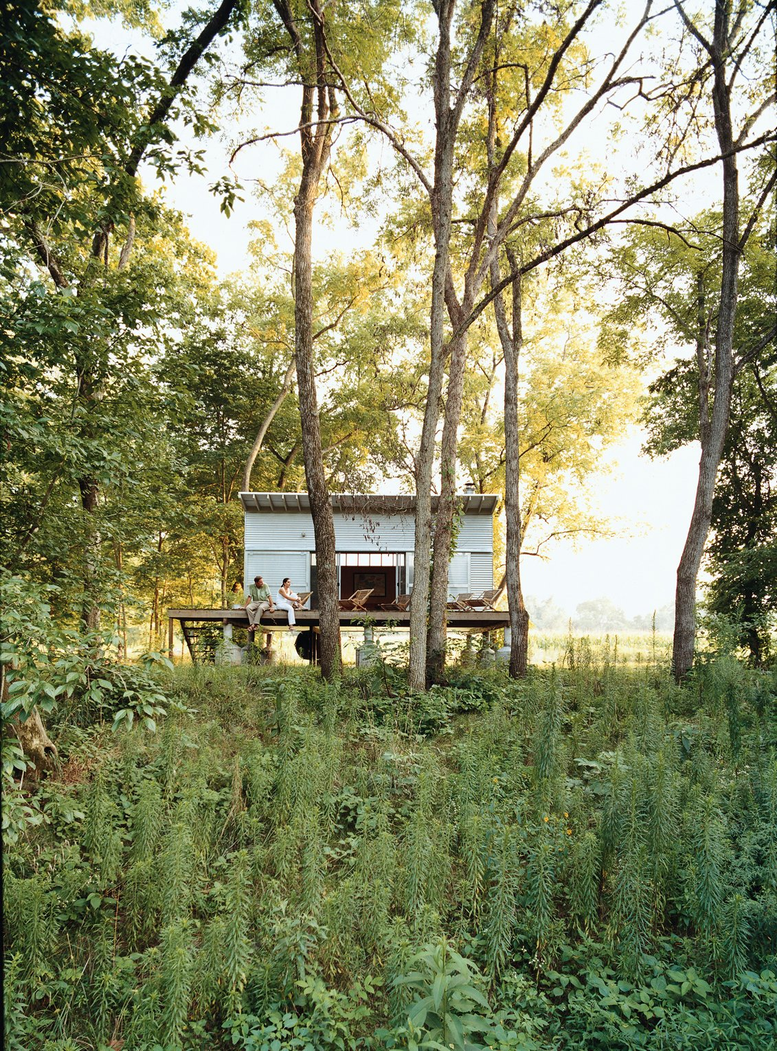 Exterior, Flat RoofLine, Cabin Building Type, and Prefab Building Type The Fish Camp acts as the couple's forest getaway, just a quarter mile from their main house.  Photo 9 of 10 in All You Need Is LV