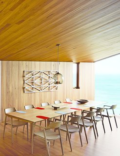 Wardle's firm also designed the dining table, where up to ten guests can gaze out at the Southern Ocean. The solid-oak Hiroshima chairs are designed by Maruni.