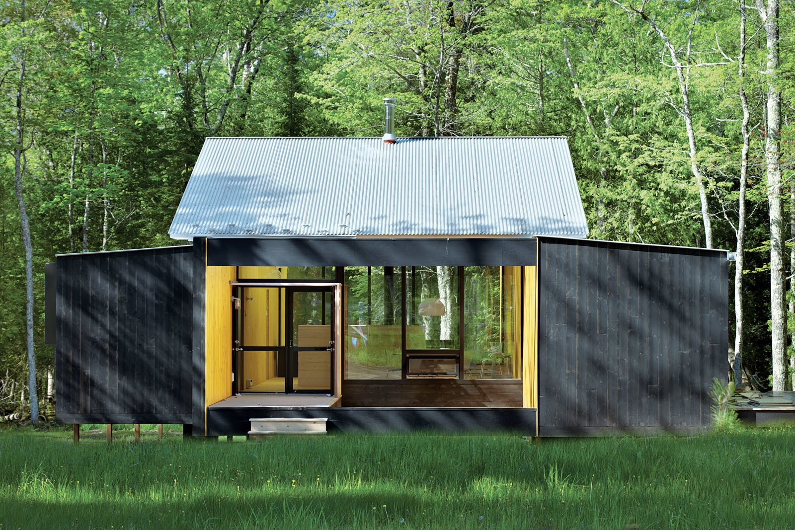 Exterior, Prefab Building Type, House Building Type, Cabin Building Type, Metal Roof Material, Wood Siding Material, and Glass Siding Material Architect Charlie Lazor opted for a wash of black on the prefab cabin he designed on Madeline Island, Wisconsin.  Photo 71 of 101 in 101 Best Modern Cabins from Small Homes in the Midwest