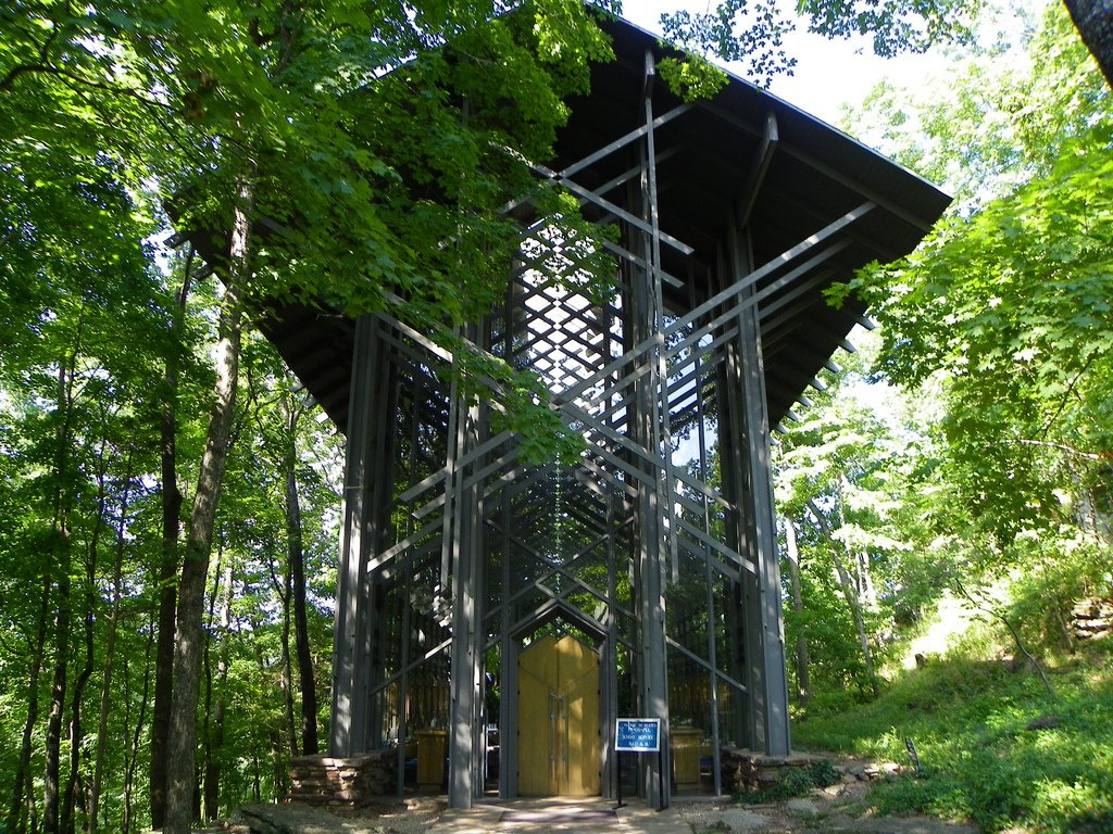 "E. Fay Jones, Thorncrown Chapel (1980)  This is not a still from Game of Thrones, but the story of this unique chapel in Eureka Springs, Arkansas, is just as fantastical. Jim Reed hired Frank Lloyd Wright associate E. Fay Jones to build the chapel as a waystation of sorts for visitors on his land, who passed through seeking the magnificent views of the Ozark hills. From the pine cut thin so it could be easily carried inconspicuously through the woods to the constantly shifting shadows created by the grid of cross trusses, Thorncrown is a place, as Jones said, ""to think your best thoughts.""  Photo courtesy David Holmes, Creative Commons  Photo 7 of 10 in 10 Inspiring Modern Churches"