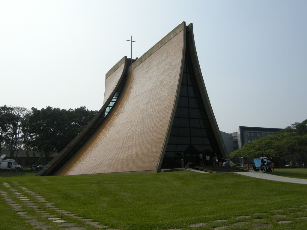 I.M. Pei, Luce Memorial Chapel (1963)   When architect I.M. Pei designed this chapel for Tunghai University in Taiwan, he had to take local conditions, like typhoons and earthquakes, into account. His plan, which, included a curved roof of glazed, diamond-shaped tiles and interior ribs of reinforced concrete that run like ribbons towards the cross mounted on the roof, was an elegant solution to the challenges of the local environment.   Photo courtesy Valter Wei, Creative Commons  Photo 10 of 10 in 10 Inspiring Modern Churches