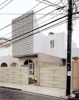 The perforated concrete panels on the façade of Casa Delpin.