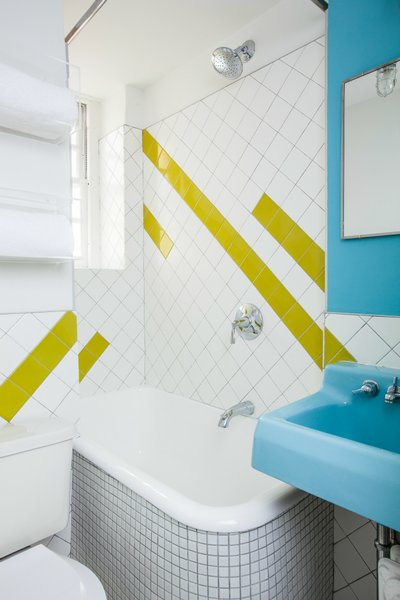 A geographic lime-green tile pattern was incorporated into the bathroom to complement the sink, which was found in an architectural salvage yard and retains its original color. Photo by Alan Gastelum.