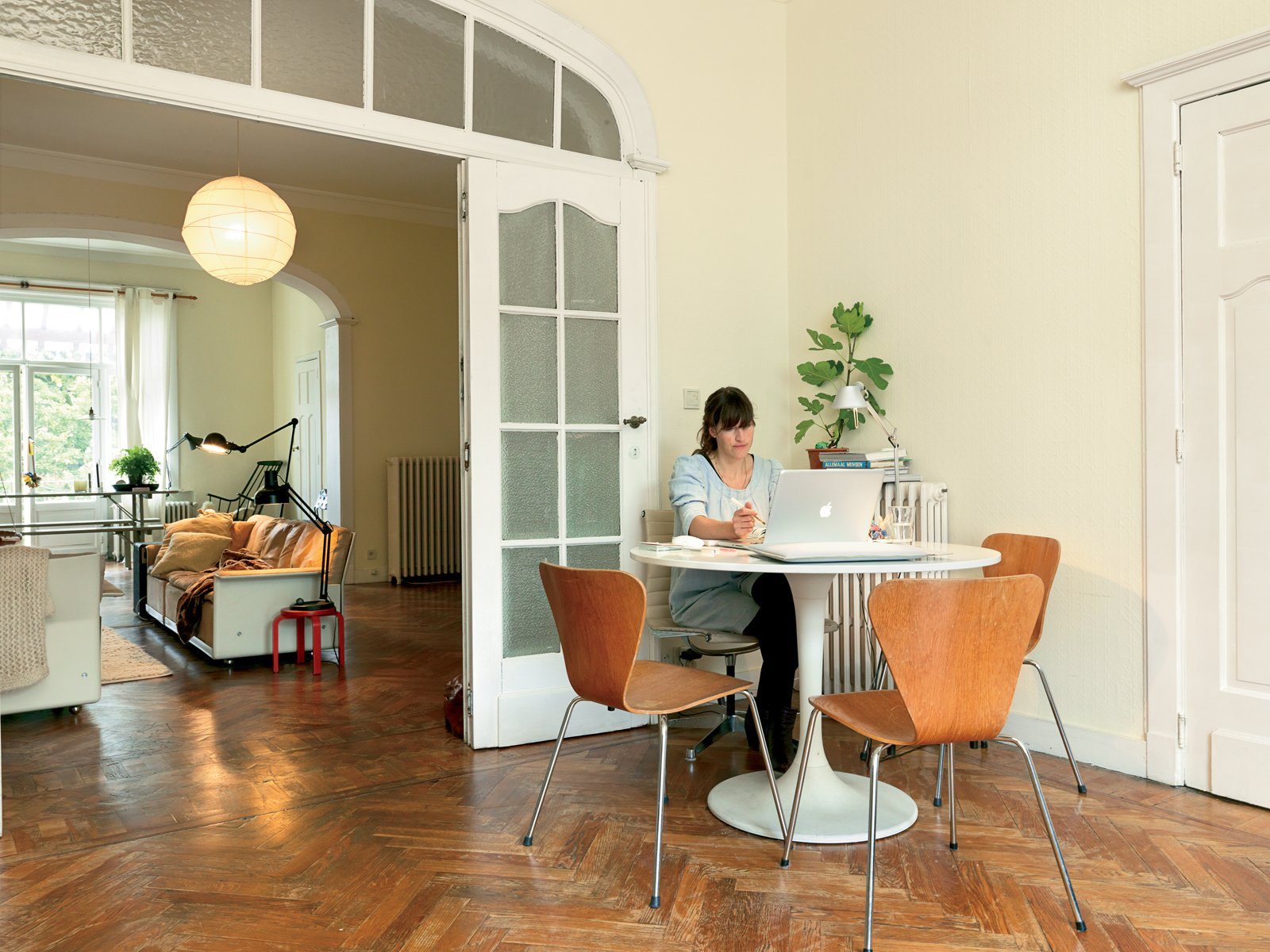 Dining Room, Table, Chair, and Medium Hardwood Floor Designer Christiane Hogner, Bruxelles  Photo 4 of 15 in Kind of New