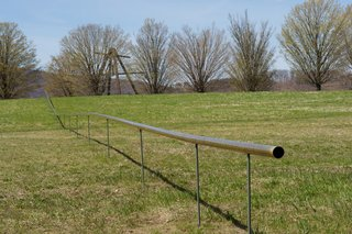 Overton's installation has an interactive aspect to it, as the visitors can talk back and forth through the pipe. Image courtesy of Storm King Art Center.