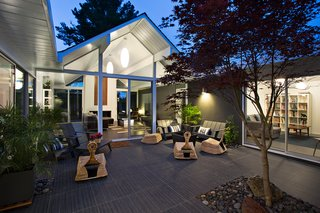The living area opens beautifully into the outdoor area, which is a key design element of Eichler homes. Photo by Mariko Reed.