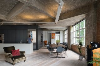 """This London renovation by Stephan Kavanaugh of the London firm Inside Out Architecture was designed to bring out the """"dramatic geometry"""" of the concrete ceiling preserving. It also calls attention to the angular pattern of the crisscrossing, concrete beams."""