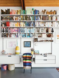 A Midcentury Home Keeps the History Alive - Photo 5 of 10 - A 606 Universal Shelving System by Dieter Rams for Vitsœ dominates one end of the living room.