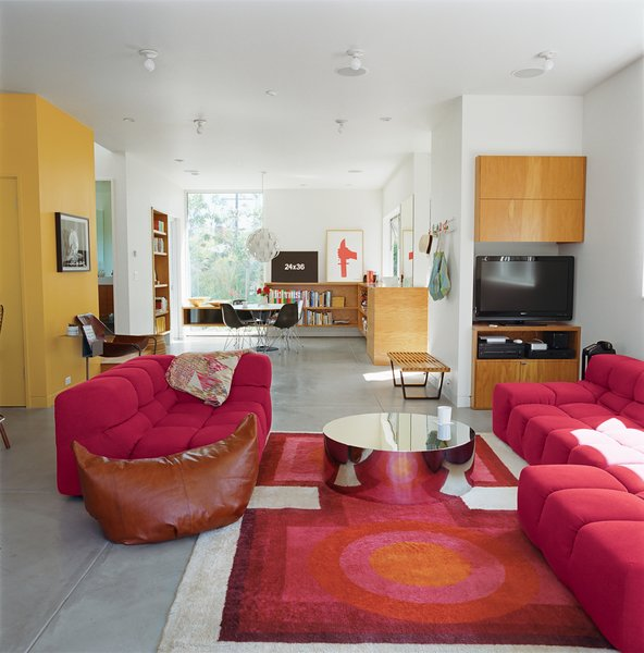Grunbaum was unafraid of a little color, as his living room proves. It includes a coffee table by Mockett and a Tufty-Time sofa by Patricia Urquiola for B&B Italia.