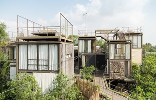 Walden Amidst the Thai Treetops (Bangkok, Thailand)<br><br>A team of Thai architects and designers took Thoreau's natural guidebook as gospel when creating this eco-friendly tree house, which sits on stilts made from reclaimed wood and bamboo. The listing's own storytelling—imagine sitting on the daybed with a glass of wine and that special someone, listening to the wind wind through the coconut trees and wind turbine—sounds like Harlequin crossed with Mother Jones, but, cliches and eco-consciousness aside, it sounds very inviting.<br><br>Listing at Breathtaking Chao Praya River View