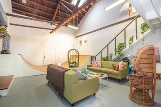 Modern Loft with Designer Halfpipe (Los Angeles, USA)<br><br>While the colorful, green-and-pink accents in this mid-century styled loft demand attention, it's hard for any furniture to overshadow the working half-pipe in the center of the 1,500-square-foot loft in Boyle Heights. While the outdoor patio and BBQ, accessible by a large roll-up door, strongly suggests grilling and evenings drinks al fresco, you may want to bring your deck just in case.<br><br>Listing at LA - Large Creative Skate Loft!
