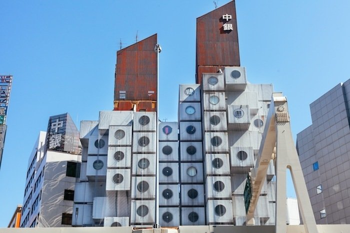 Fifth Element Micro-Apartment in Tokyo (Tokyo, Japan)The units inside the Nakagin Capsule Tower, designed by Kisho Kurokawa in 1972, are relics of a future imagined but not achieved, white plastic spaces with a bank of appliances, a minimum of comfort and a vision of small-scale living measuring roughly 7.5 x 12 x 7 feet. There's no extra charge to share the historic space with someone, though that may be more of a challenge than you expect.    Listing at Historical Nakagin Capsule Tower  Photo 8 of 15 in 15 Modern Summer Rentals