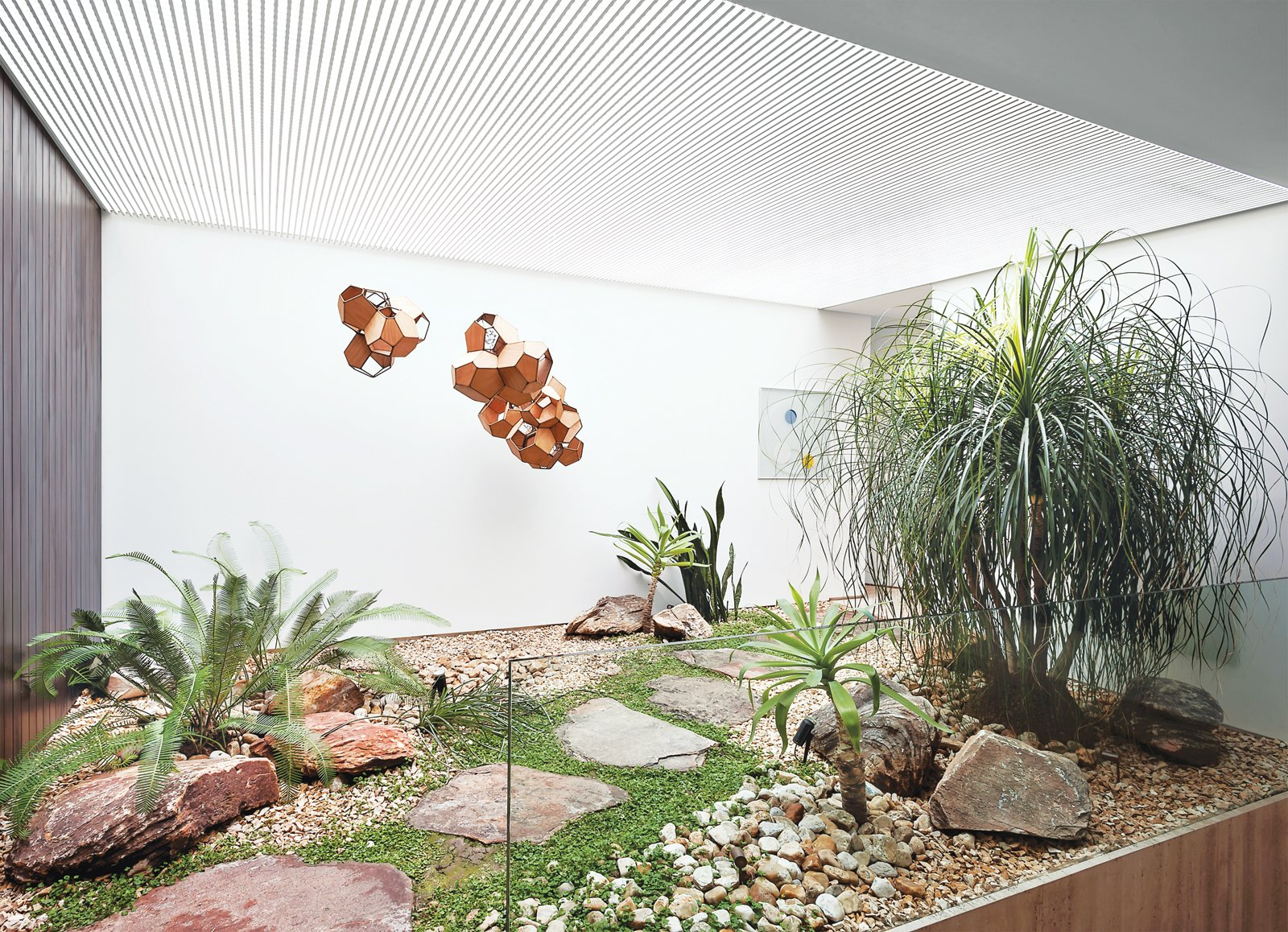 A small interior courtyard features a huge skylight and the sculpture Air-Port-City/Cloud-City/ 14-5-4 Cloud Modules 30 Net by Tomás Saraceno.  Photo 7 of 11 in These Courtyards Bring Indoor/Outdoor Living to 10 Modern Homes from Blockbuster Movies Can't Compete with These Monumental Views