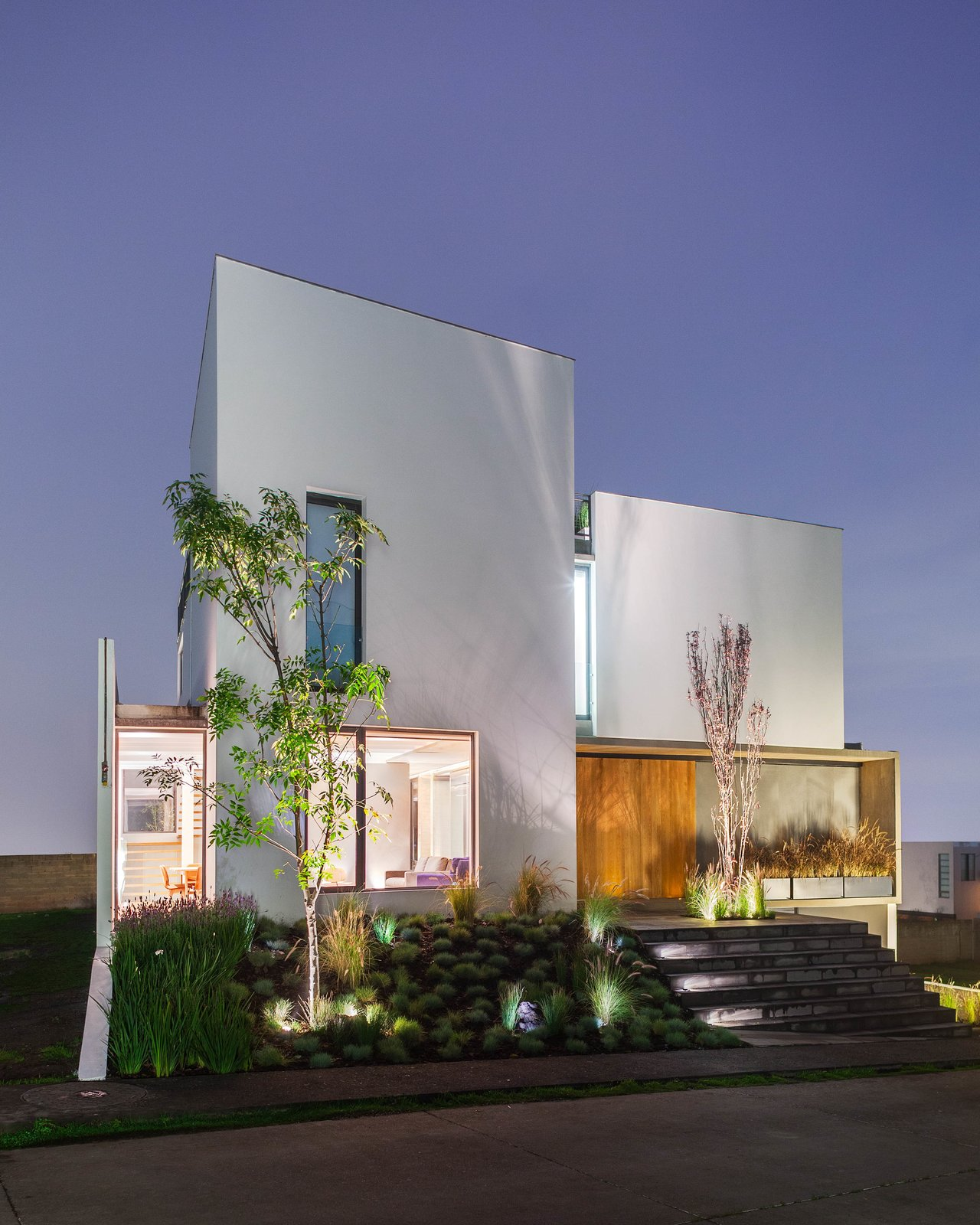 The facade at dusk. Photo courtesy of JSa.  Photo 5 of 8 in An Open, Light-Filled House in Mexico City