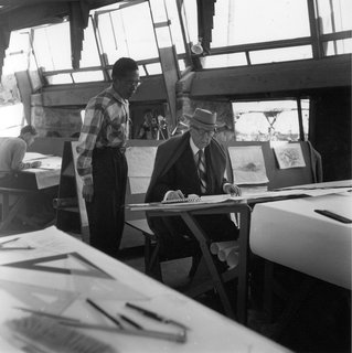 Dwell Reflects on Frank Lloyd Wright in Honor of the 150th Anniversary of His Birth - Photo 6 of 10 - Frank Lloyd Wright at a drafting table