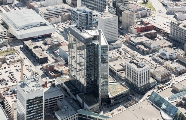 Manitoba Hydro Place (Winnipeg, Manitoba: 2009)  How refreshing is it to see a power company be so respectful of power? Manitoba Hydro didn't merely create a new headquarters when it unveiled this towering 23-story building, it created a case study in intelligent high-rise construction. A center chimney between three six-story atria cools, warms, and recycles air before its distributed to the rest of the structure, part of an almost organic system that utilizes geothermal systems to provide energy for 100% of the cooling and 75% of the heating. Along with a system of radiant slabs embedded in the concrete and automated lighting systems, the LEED Platinum-certified design by KPMB Architects showcases the power of passive energy.   Photo by Maris Mezulis  Photo 5 of 10 in 10 Green Commercial Buildings