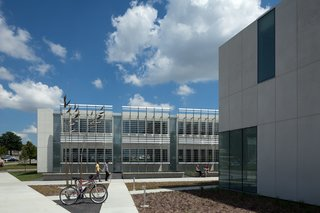 Iowa Utilities Board, Office of the Consumer Advocate (Des Moines, Iowa: 2011)<br><br>There are apt metaphors to be made about this government office building, erected on the site of a former landfill, yet built in such a way that nearly 90 percent of construction waste was recycled. Designed by BNIM architects, the structure's two wings were made from white Thermomass precast concrete, and gaps that might lower energy efficiency were meticulously removed. The result is a sleek profile that achieves a 75 percent reduction in energy usage compared to a similar code-compliant building.<br><br>Photo by BNIM