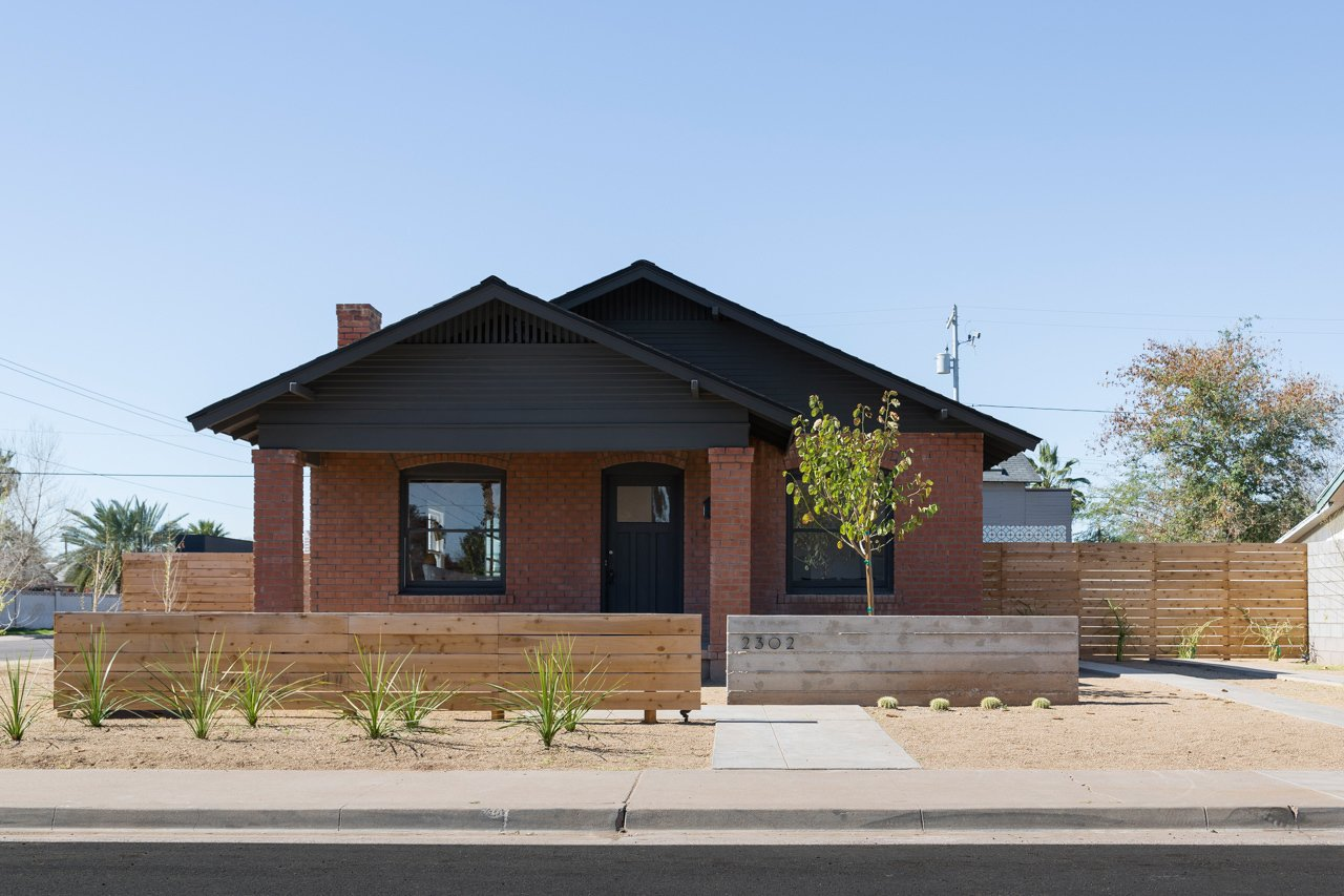 Busick refreshed the house's east-facing façade by painting the trim a bold black that echoes the steel addition at the rear.  Photo 1 of 11 in Amazing House is Half Historic and Half Modern