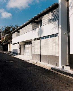 Corrugated steel cladding defines the exterior.