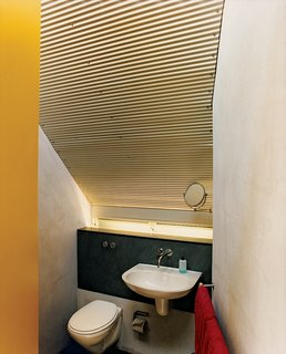 Tight quarters in the bathroom allow for a bit more room in the main living spaces.