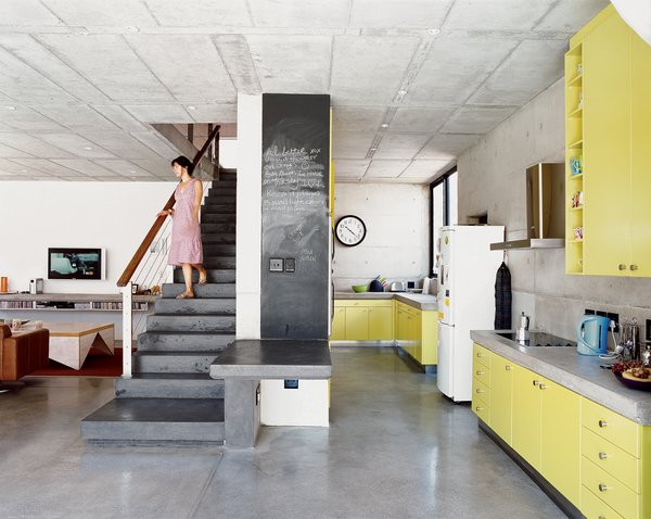 The freestanding staircase was built three times before Gregory deemed it structurally sound—a tribute to the architect's tenacity. The high-tech end result was achieved using small custom-made plastic reinforcing fibers. The galley-style kitchen with its bold use of color was Caryn's choice. She fell in love with the name of a paint swatch called Canary Yellow and then left it to Gregory to fine-tune the exact hue.