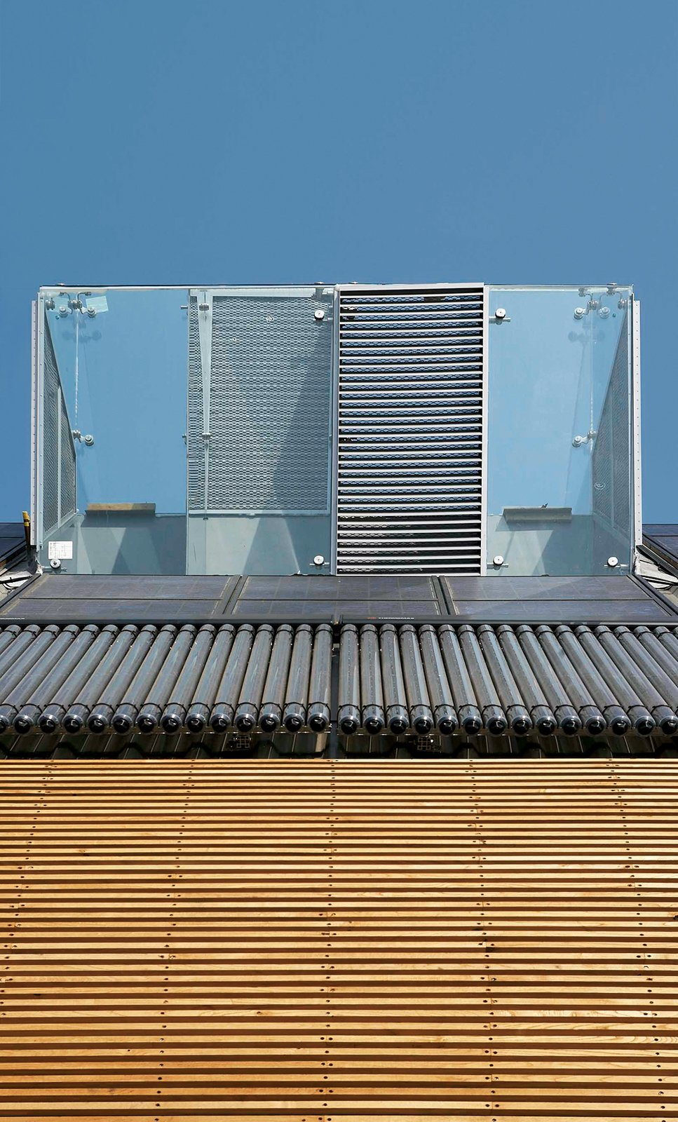 At the top of the house sits the ultra-modern descendant of an ancient Middle Eastern cooling tool: an air shaft with operable shutters that release hot and cool air.  Photo 2 of 3 in London Cooling