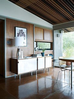 The sideboard in the dining room is by Florence Knoll.