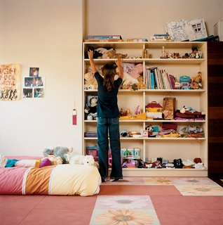 To prevent bookshelves from toppling and injuring a child, make sure to secure these units with bolts to your walls. This is a small and simple change that won't even be visible, but it is guaranteed to make you feel much more relaxed when you see your kids reaching for higher-placed items.