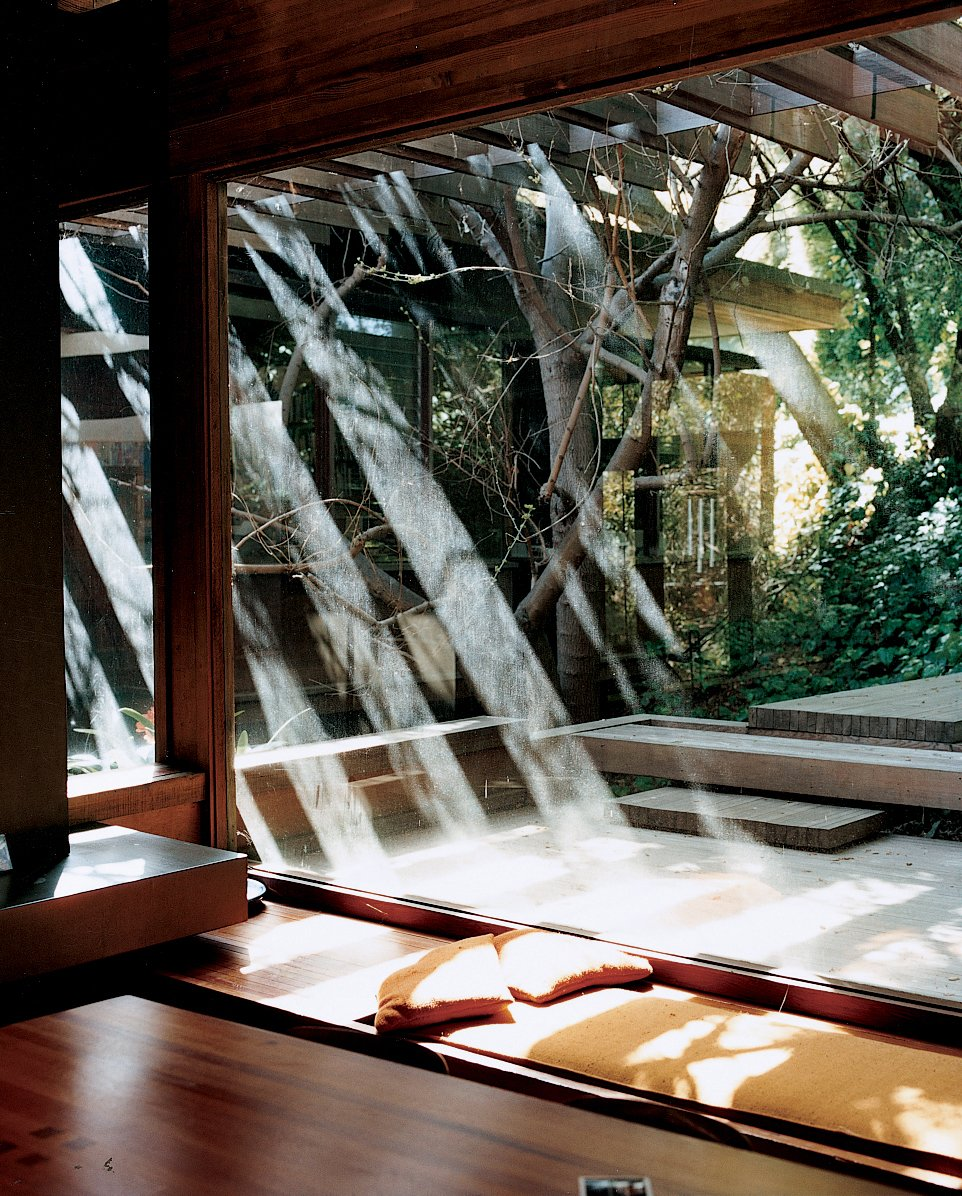 Windows Wooden beams extend beyond the structure to create shading trellises for the terraces at the front and the back.  Photo 9 of 12 in Ray Kappe-Designed Multilevel House in Los Angeles
