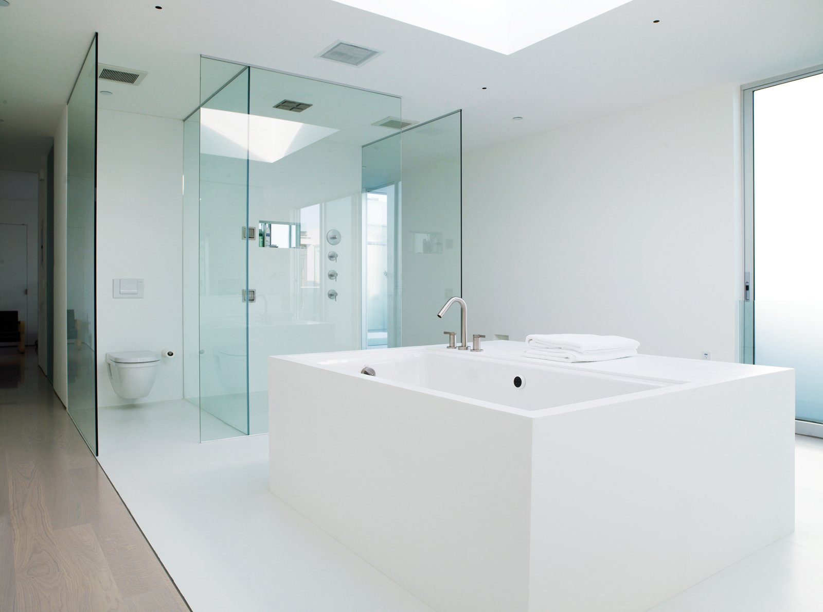 Bath Room In the master bathroom, an oversize tub is graced with a generous skylight above it.  Photo 6 of 11 in Aluminum Clad Residential Units in San Francisco