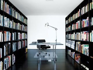 The library is formed simply by two custom bookcases enclosing the space.