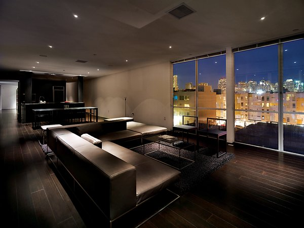 The penthouse living room is furnished with Ile Club by Piero Lissoni for Living Divani. The Metropolitan Riverside Park City Lights rug is by Merida.  Photo 11 of 11 in Aluminum Clad Residential Units in San Francisco