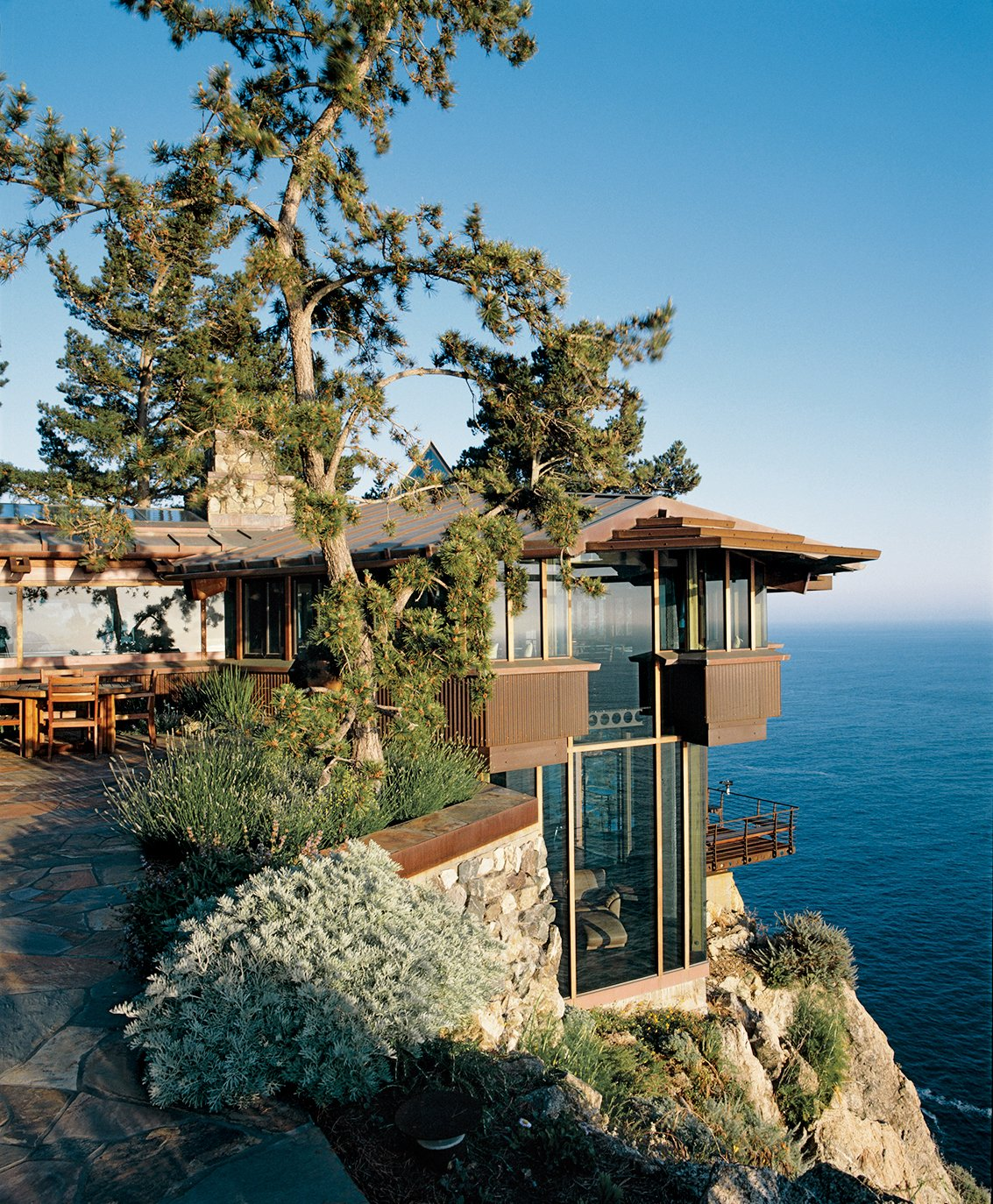 Exterior, House Building Type, Wood Siding Material, and Glass Siding Material The Partington Point House, which Muennig renovated in 1995.  Photo 5 of 9 in Big Sur: Coastal Commissions
