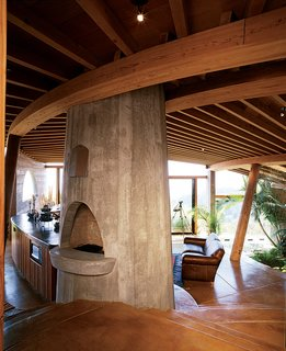The interiors of many of Muennig's houses emphasize natural building materials such <br><br>as wood, concrete, and stone. Plant life and nature are intrinsic to the Pfeiffer Ridge House IV.